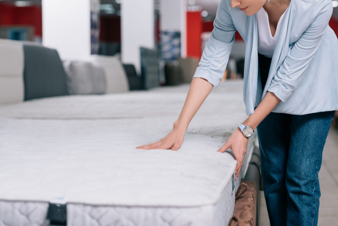 partial view of woman touching orthopedic mattress WUZJ3RA