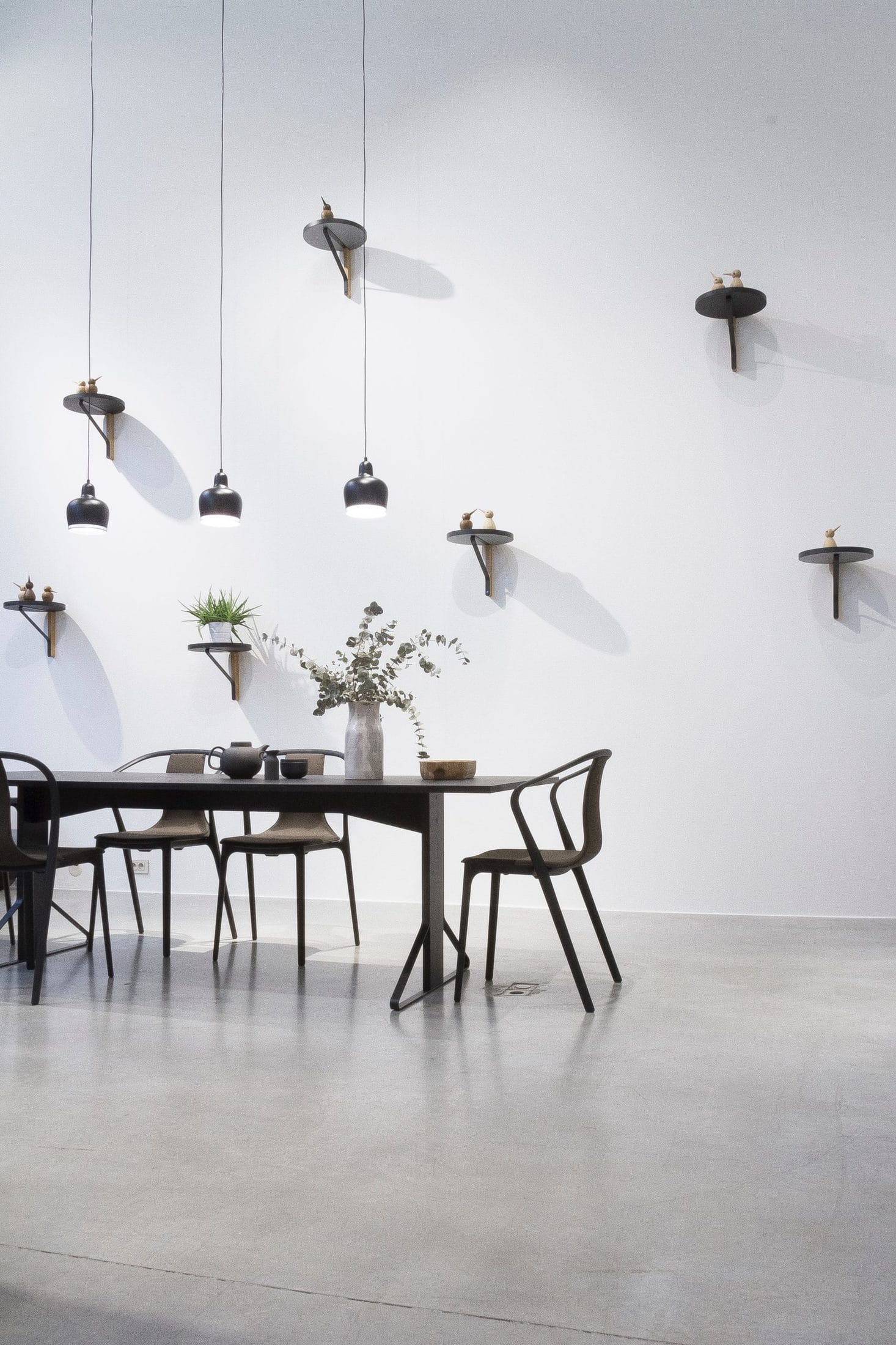 black dining set near white wall