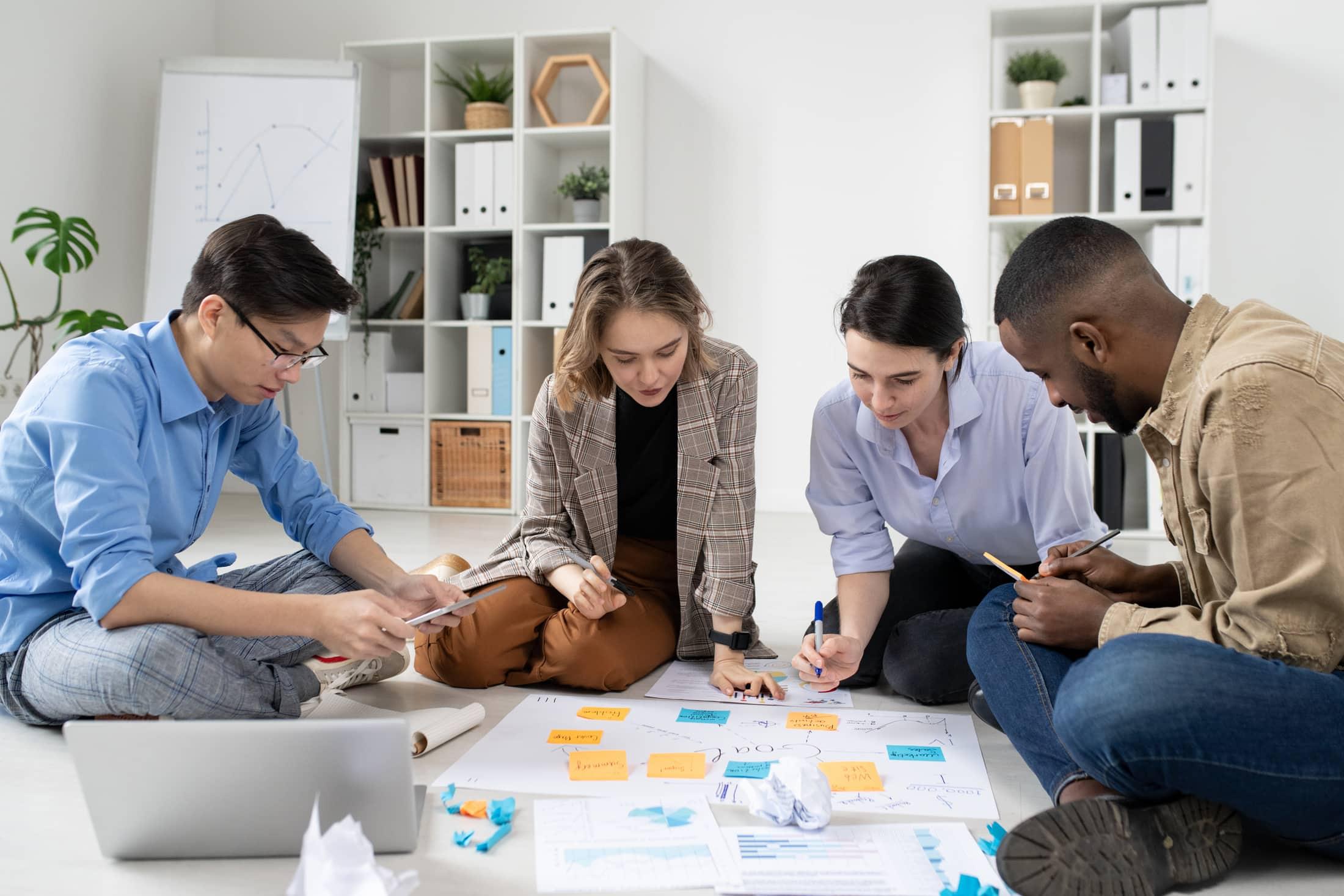 startuppers analyzing marketing strategies 9TFA6AG