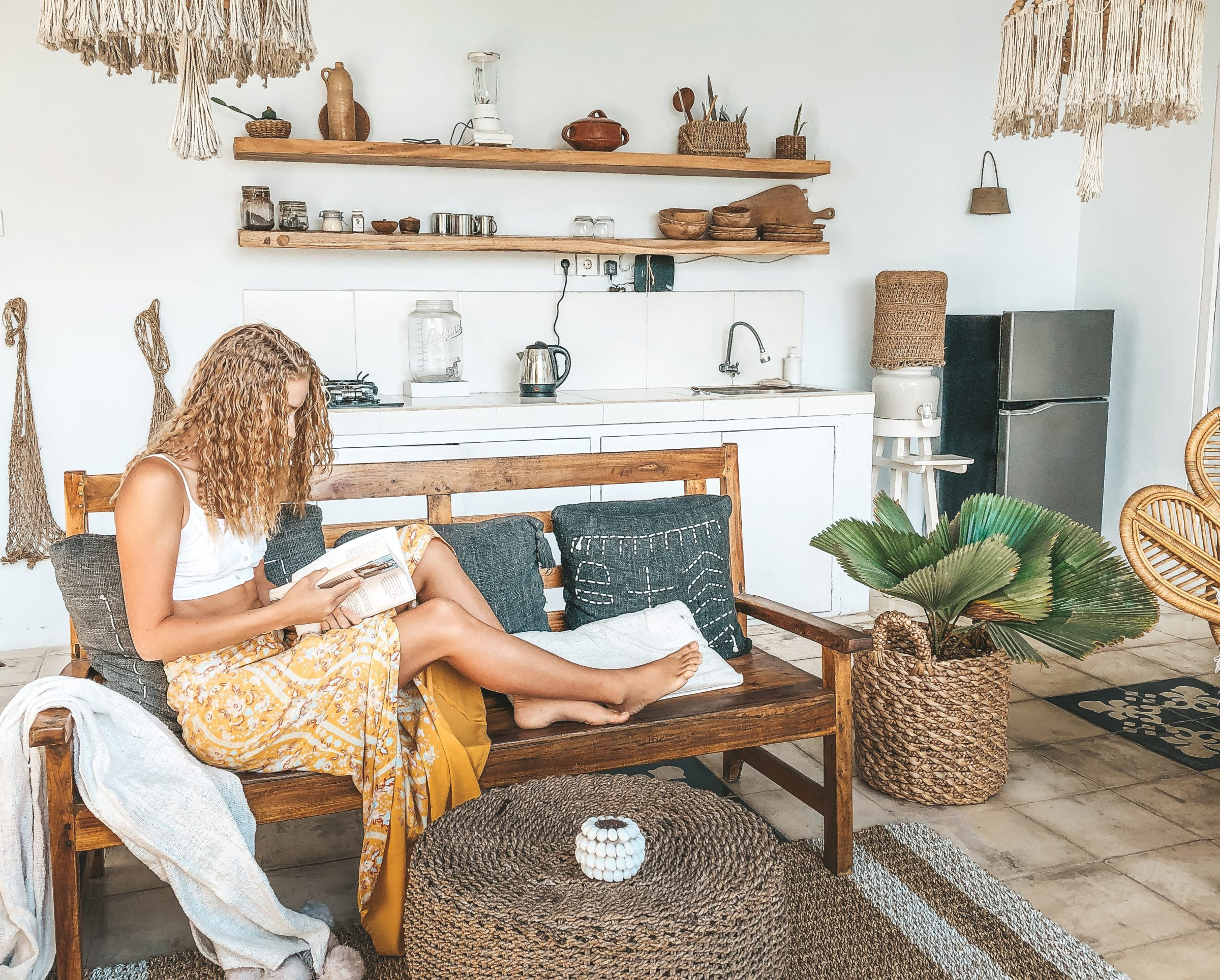 bohemian dressed woman relaxing in the living room BUUFFSU