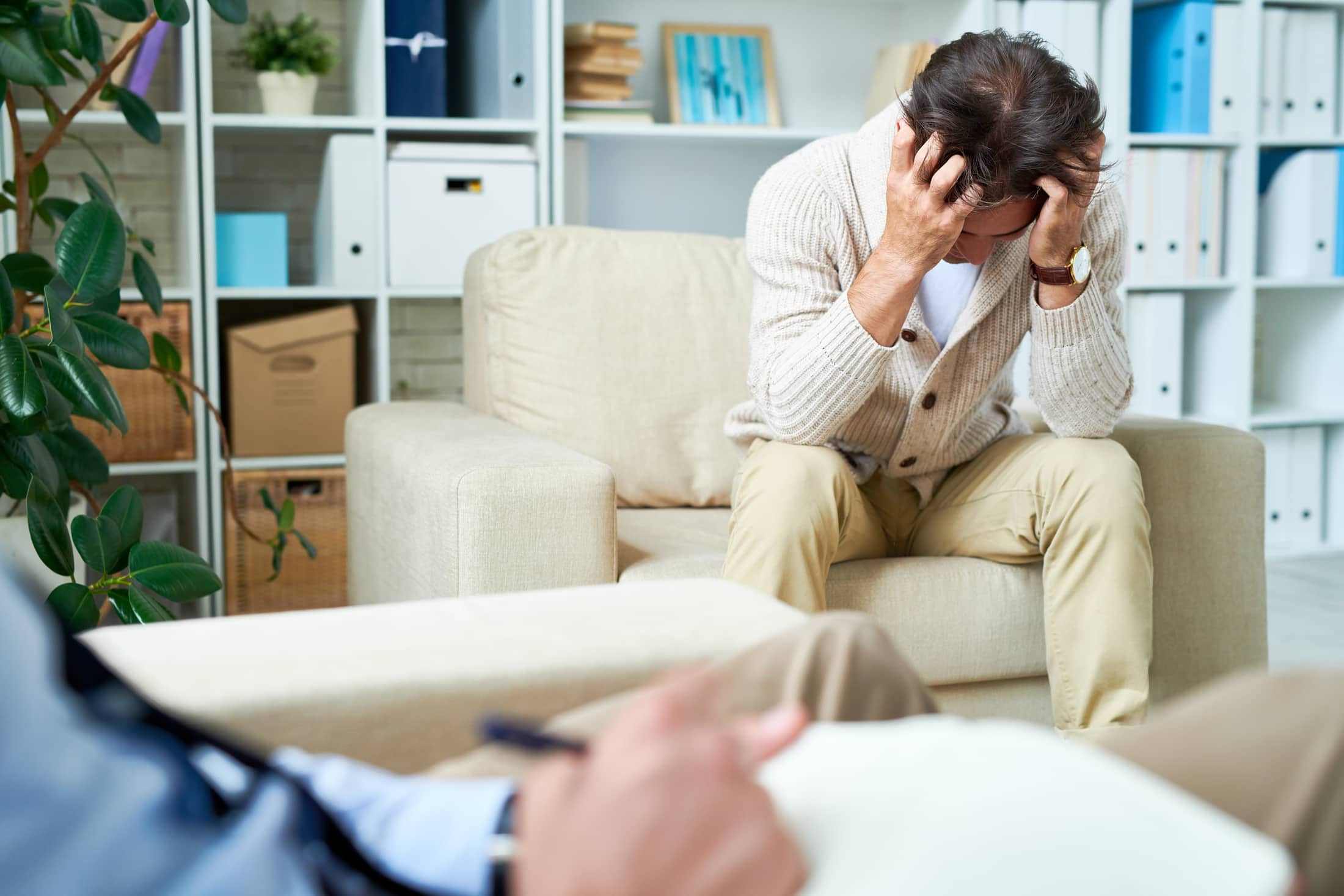 depressed man at psychotherapy session FZELMVY