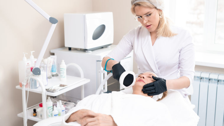 doing cosmetic laser procedure E6LMY35