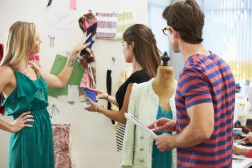 meeting in fashion design studio PHK7DGY