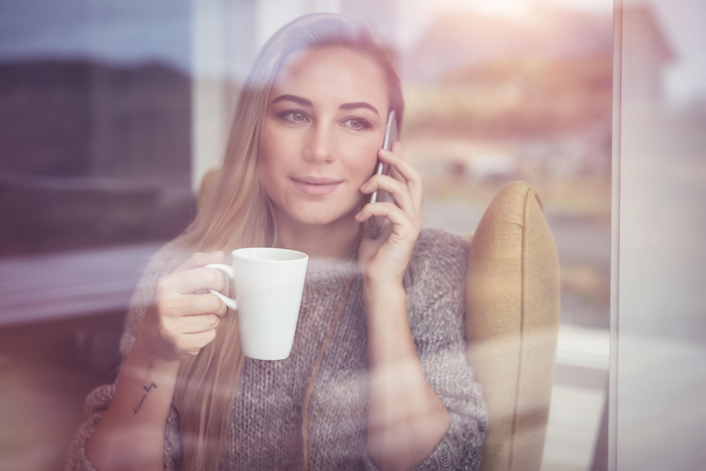 pretty woman talking on the phone PURCPNA