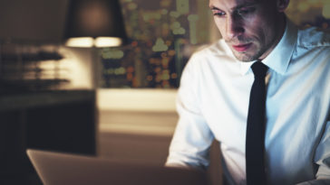 serious businessman working on laptop KVWSYM4