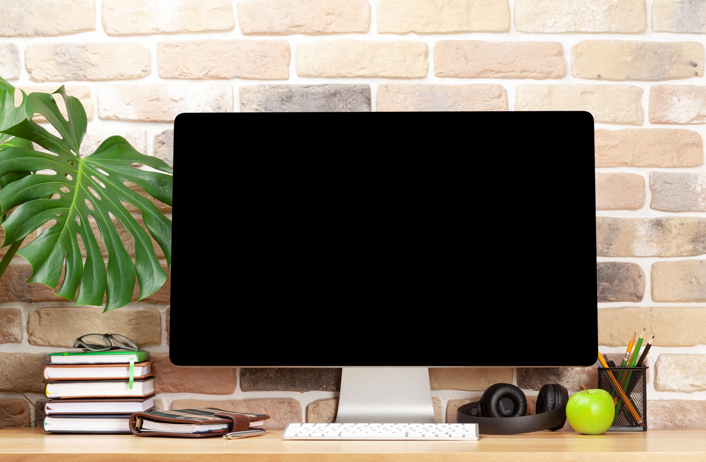 studio workspace with desktop computer supplies an UPXYACK