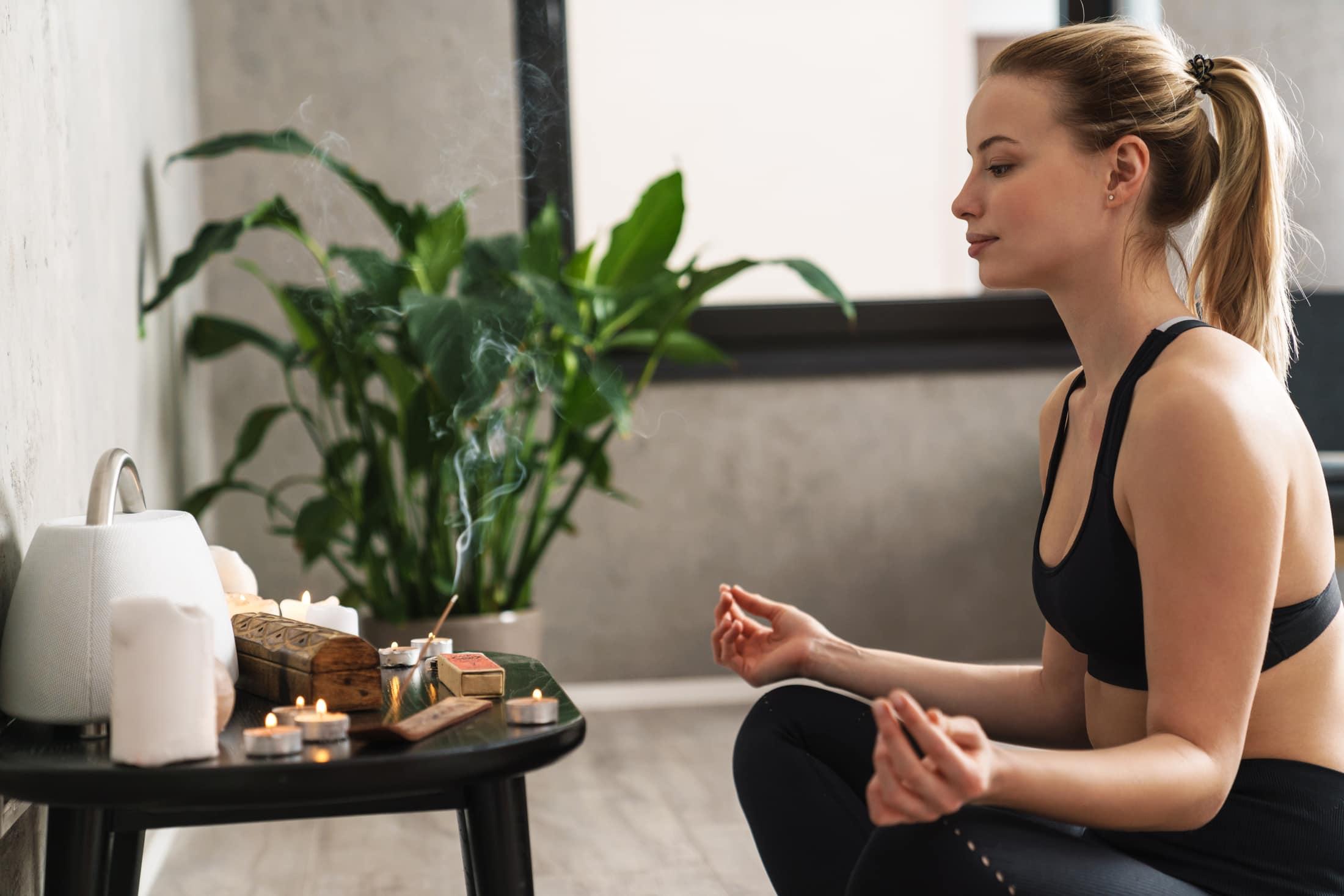 yoga meditation at home indoors K9TBJDJ