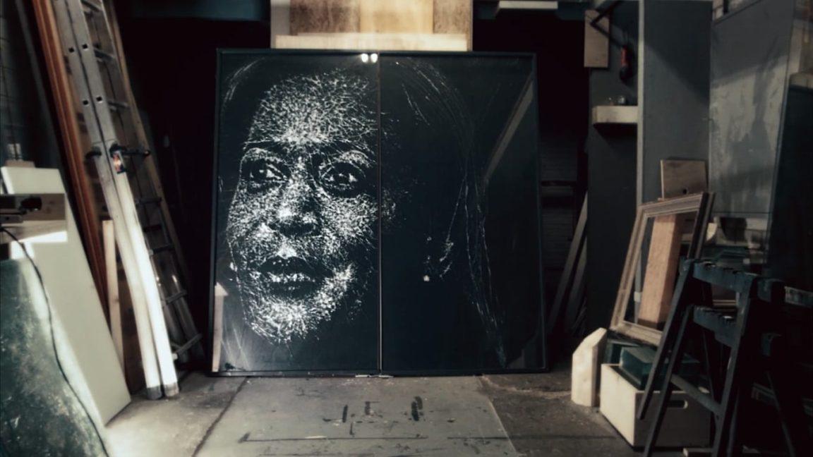 Kamala Harriss face is drawn on broken glass as a