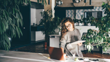 freelancer woman using laptop at comfortable offic 5FG2CHT