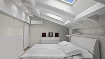 modern bedroom in the attic with skylight 7U97MVM
