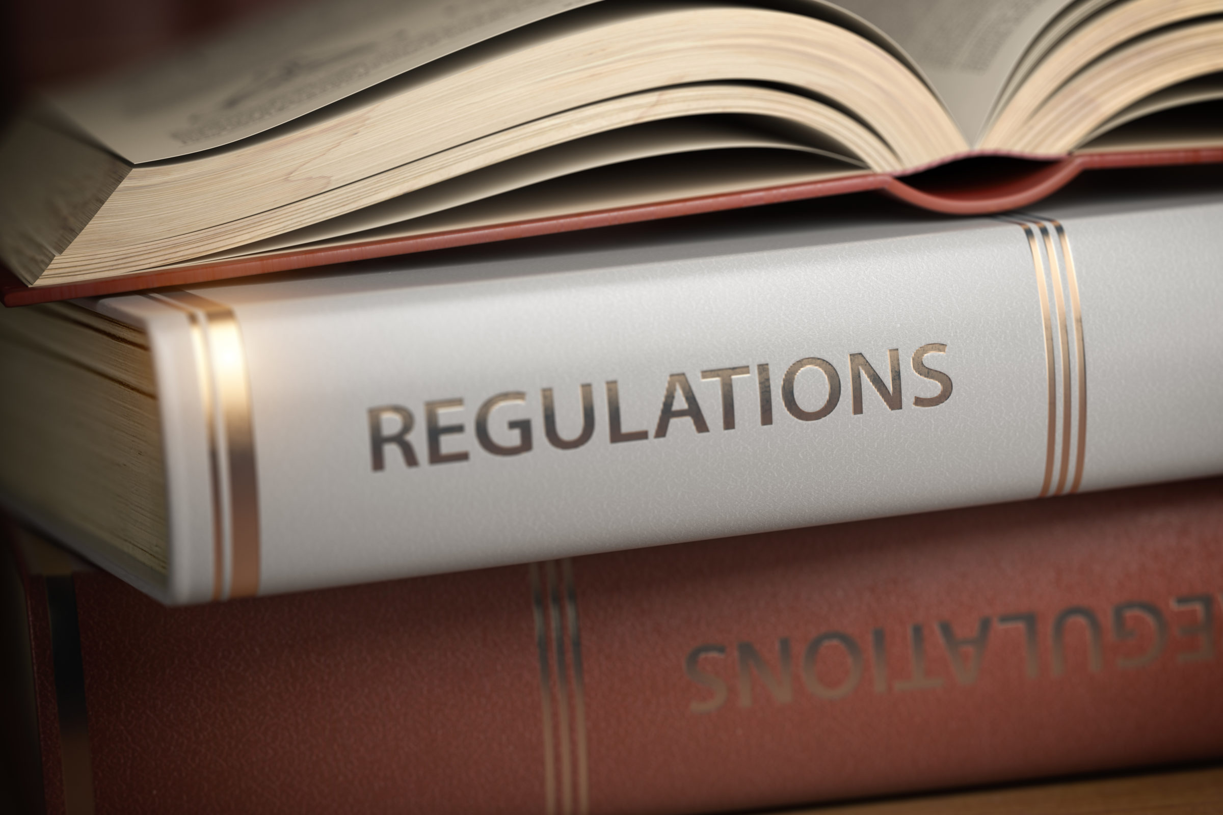 regulations book law rules and regulations concept DX9P32Z
