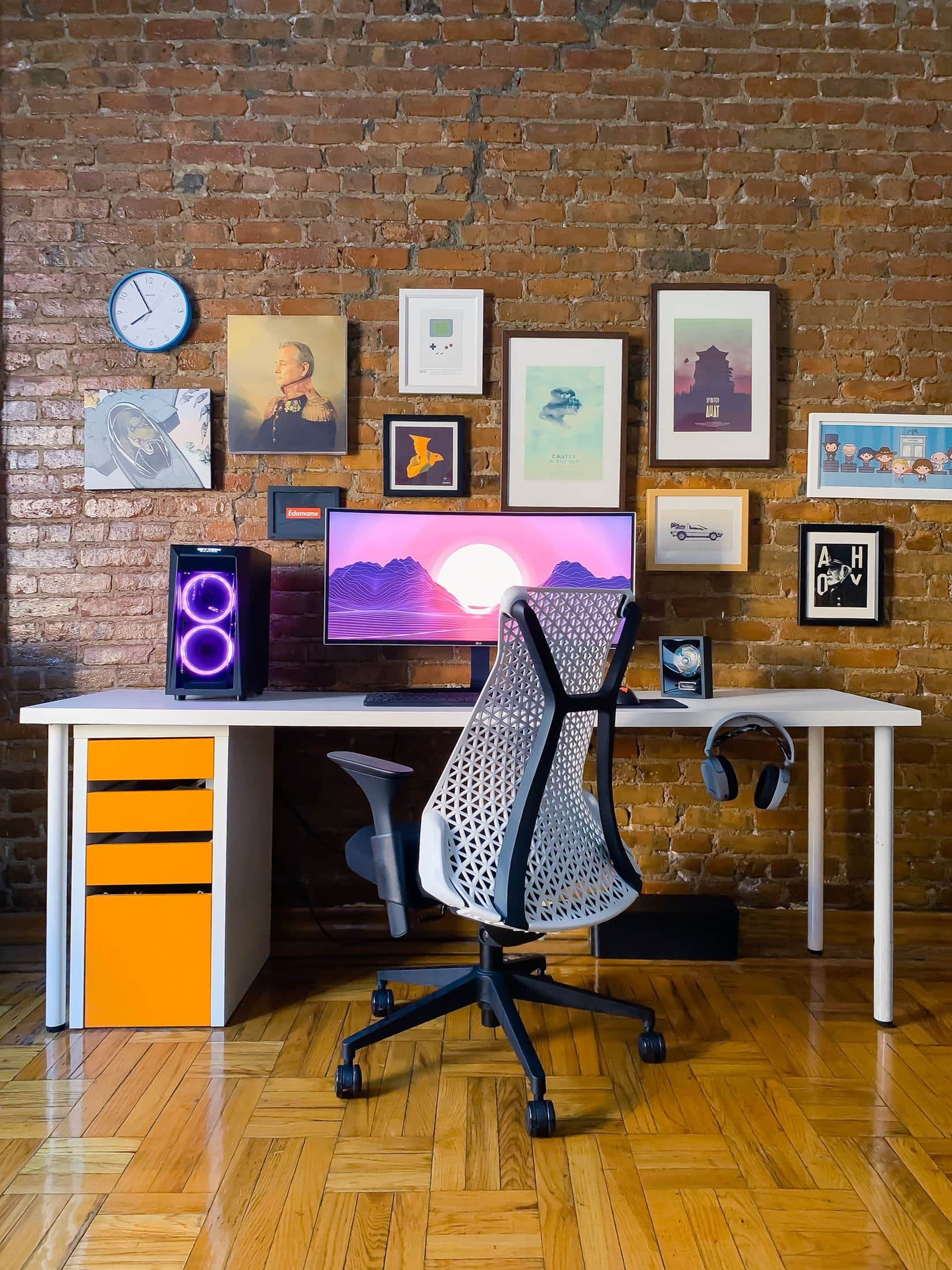 black rolling chair near white wooden desk