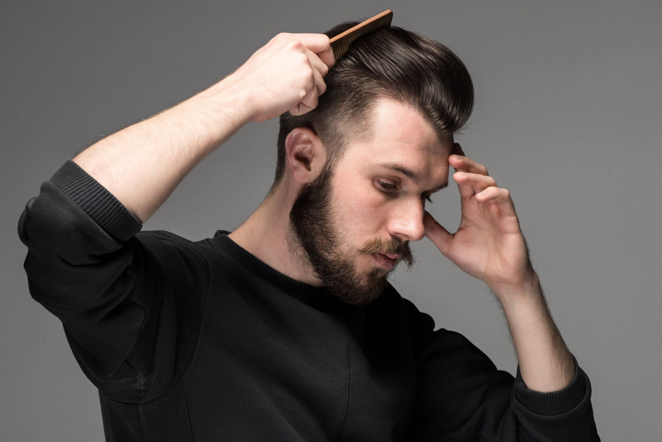 young man comb his hair P66K76F scaled