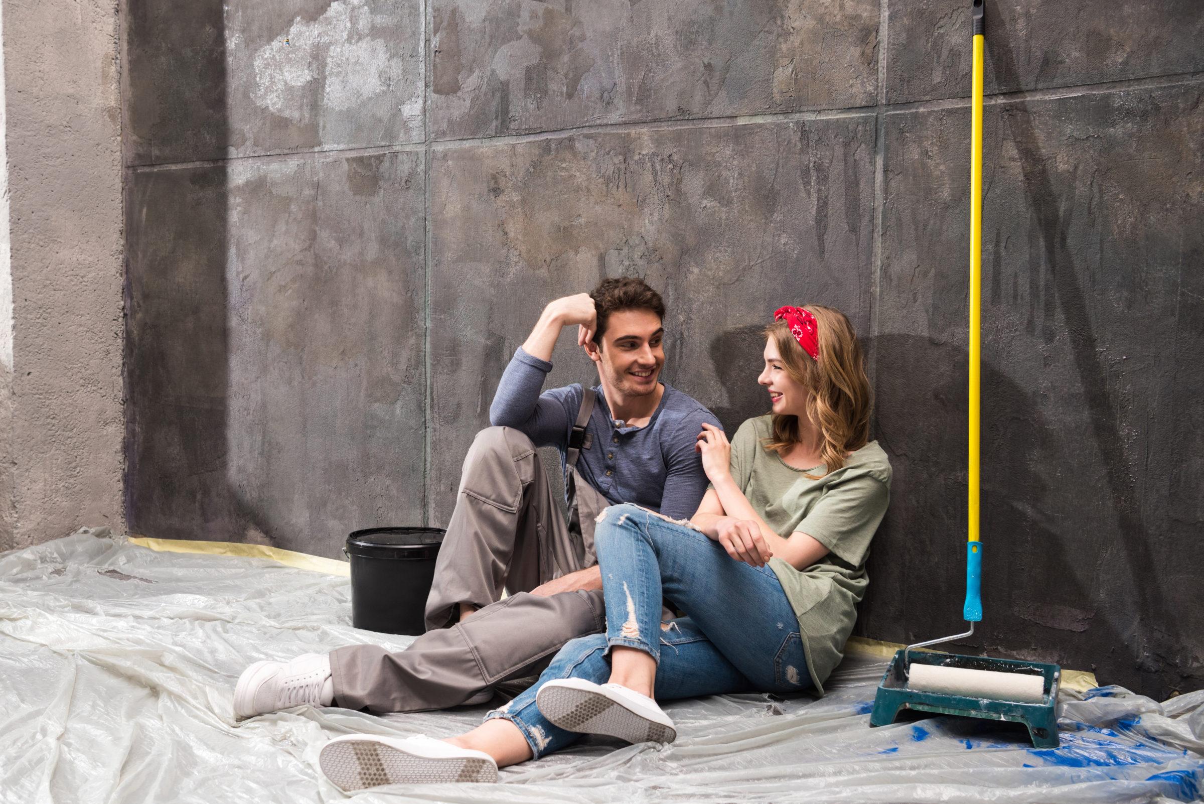 young professional couple sitting together on floo KU7C36K