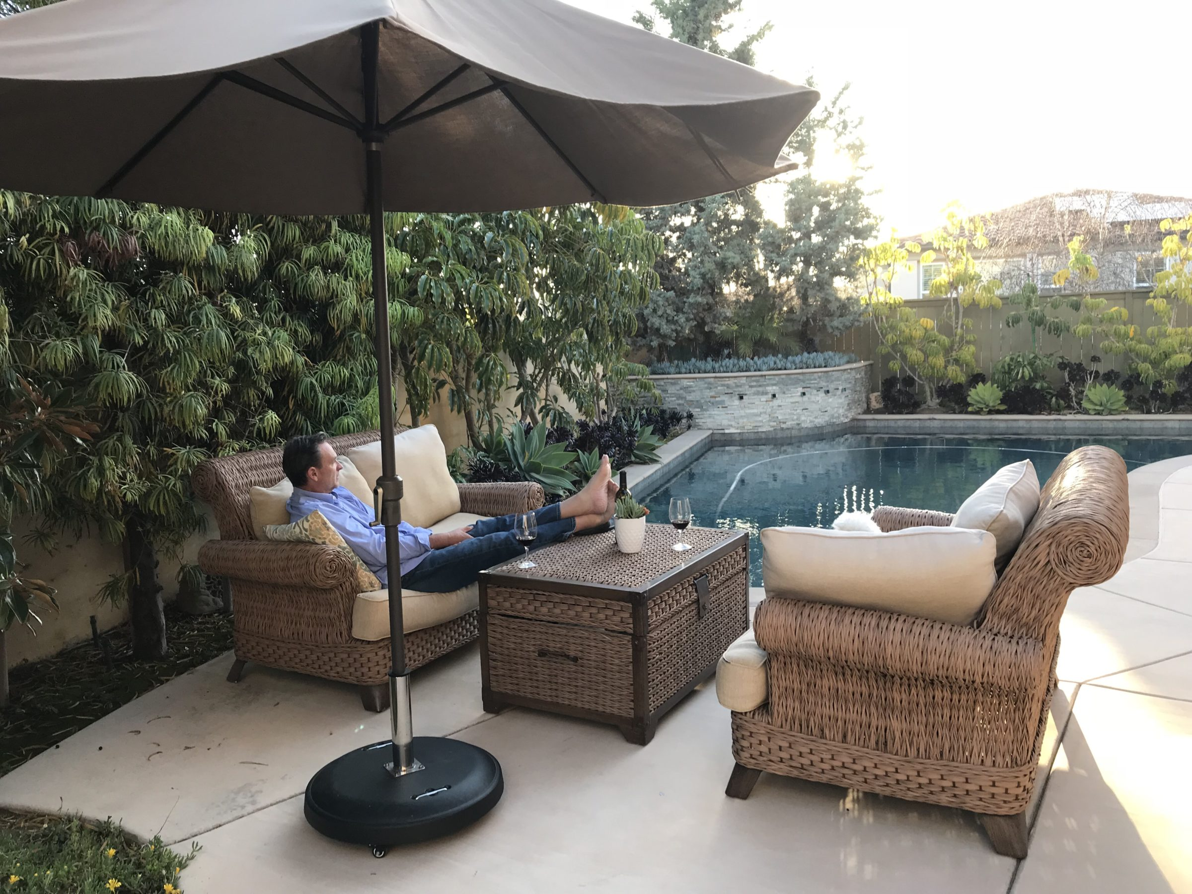 a man is sitting on outdoor patio furniture by the U9MQ9LS