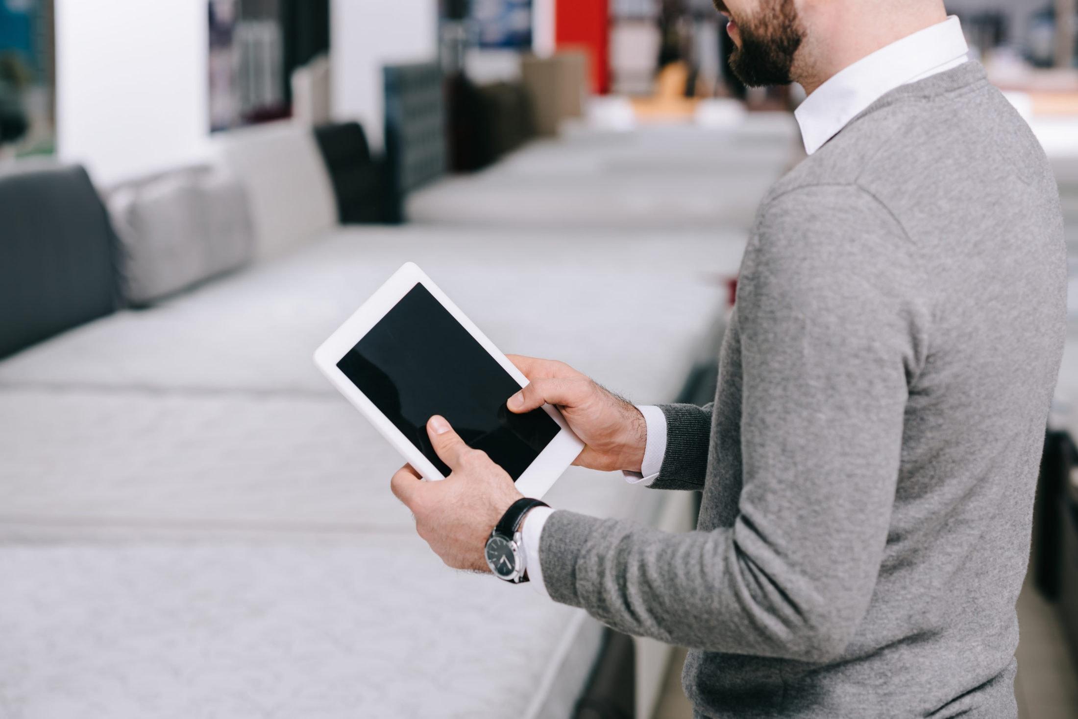 cropped shot of man using digital tablet with blan 7VPGU6U scaled