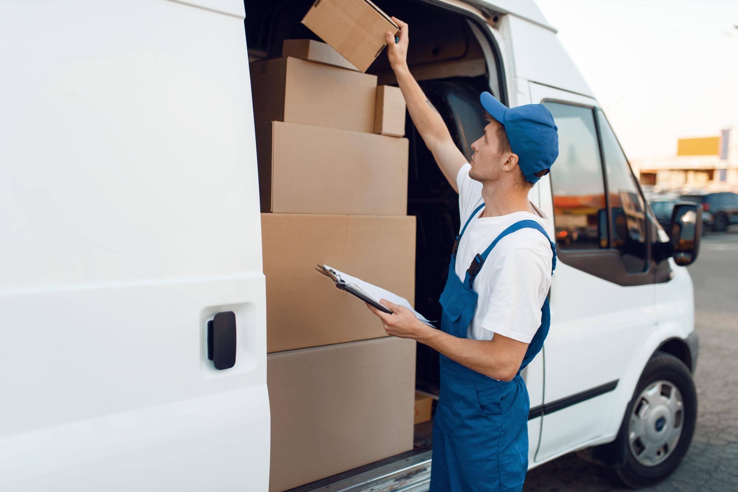 deliveryman in uniform check boxes in the car 2021 04 03 14 38 23 utc