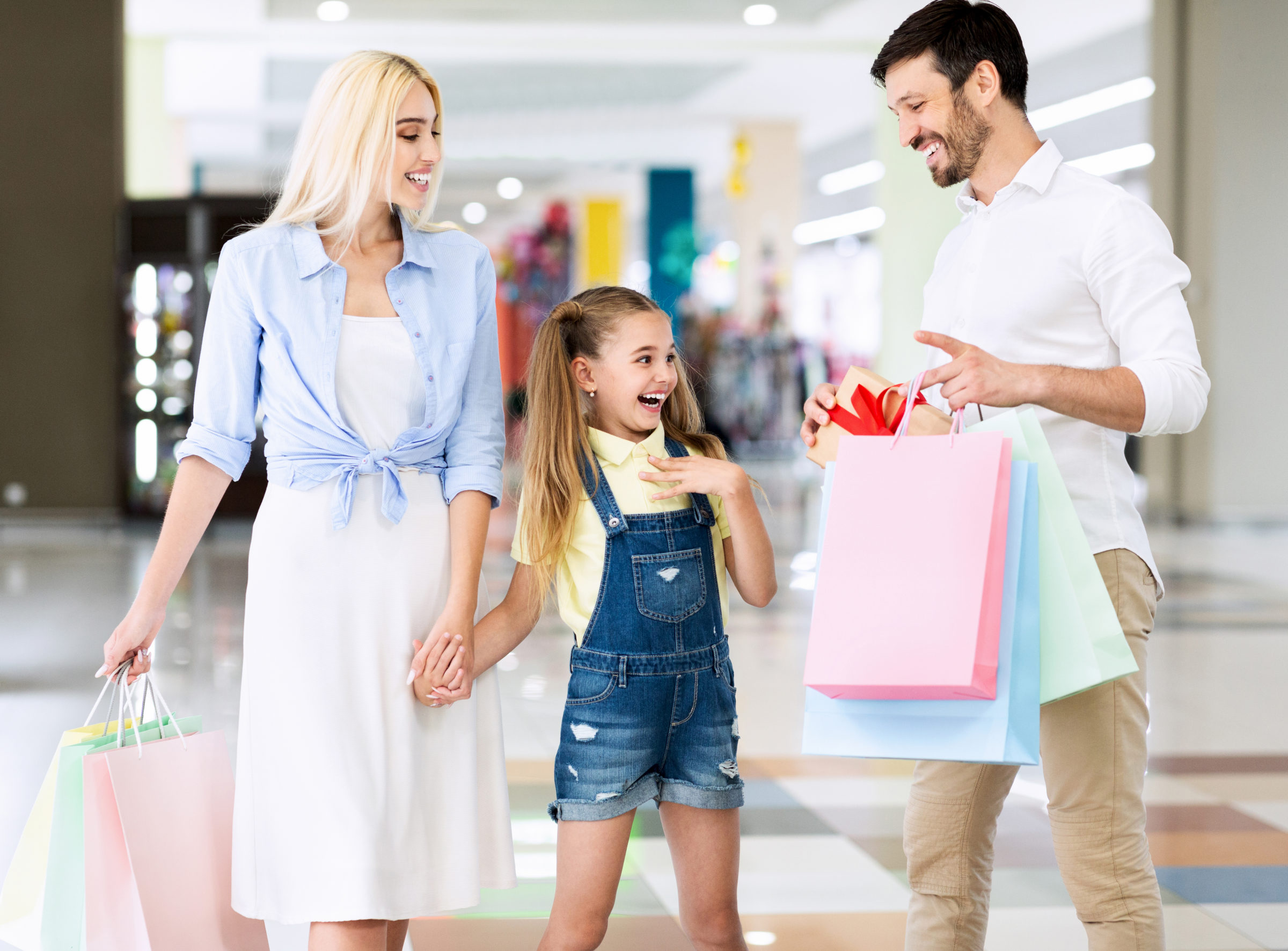 parents giving daughter a gift during shopping in 2021 04 02 20 25 30 utc