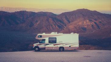 retro rv camper in the desert PMZMLQV