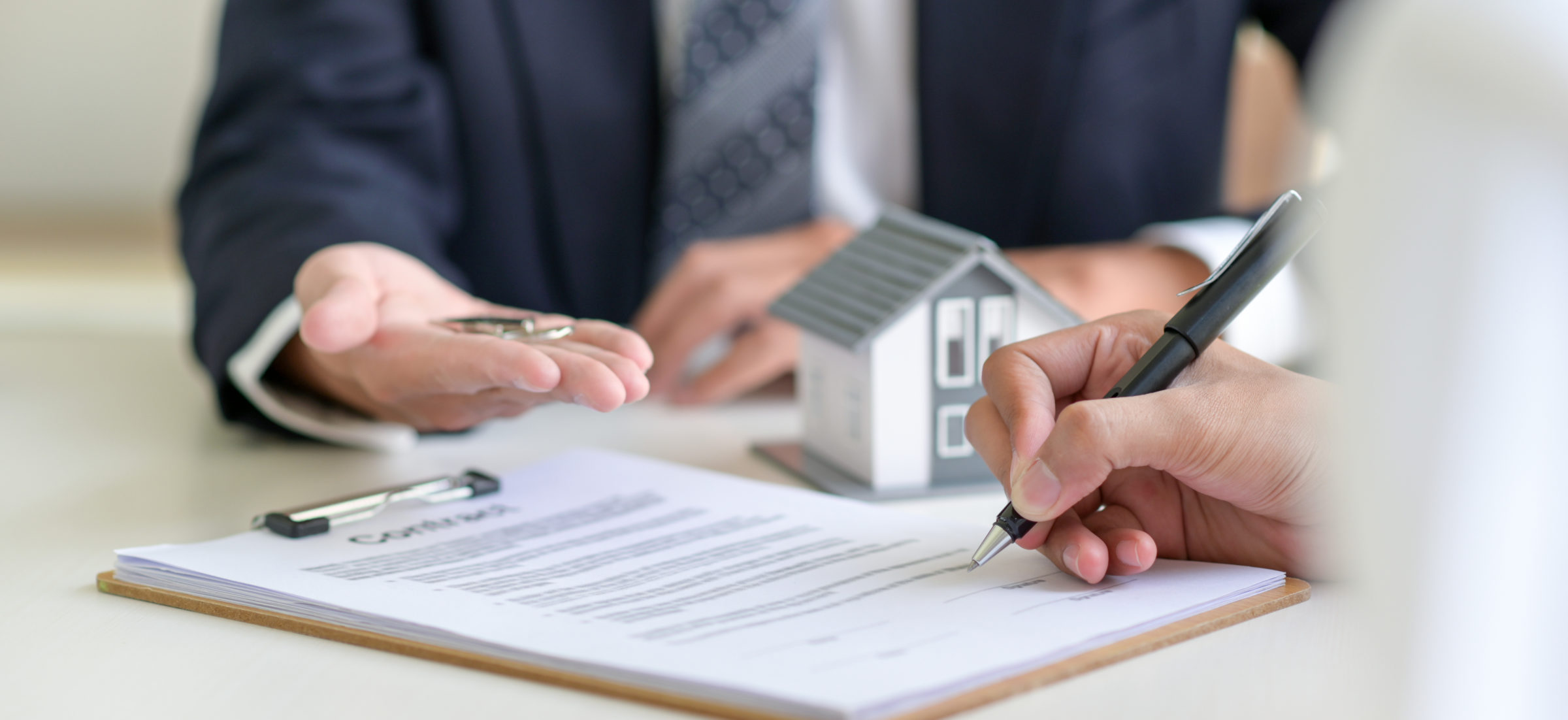 signing a loan for a home purchase CVQDFTV