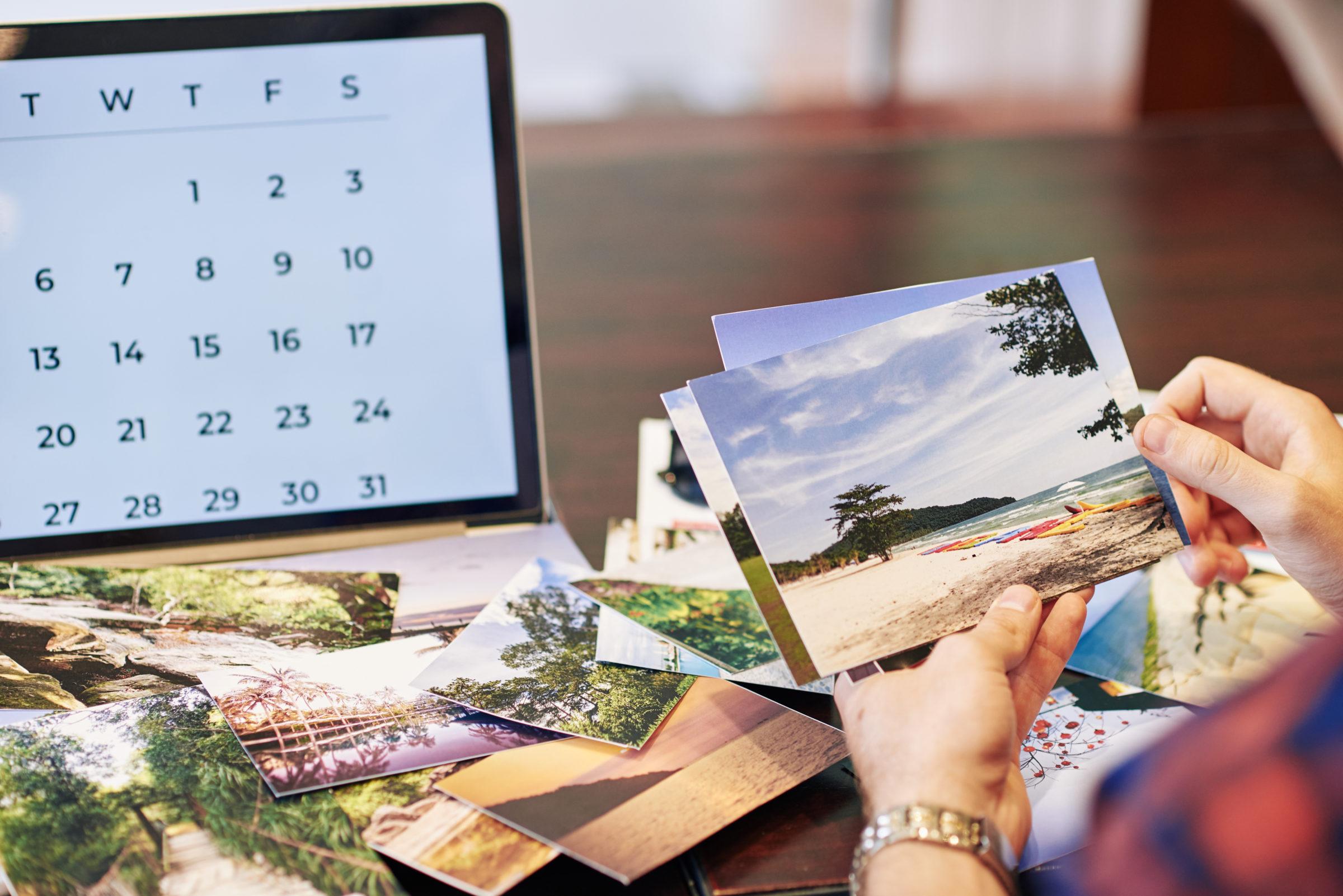 traveler checking printed photos 2021 04 04 19 53 35 utc