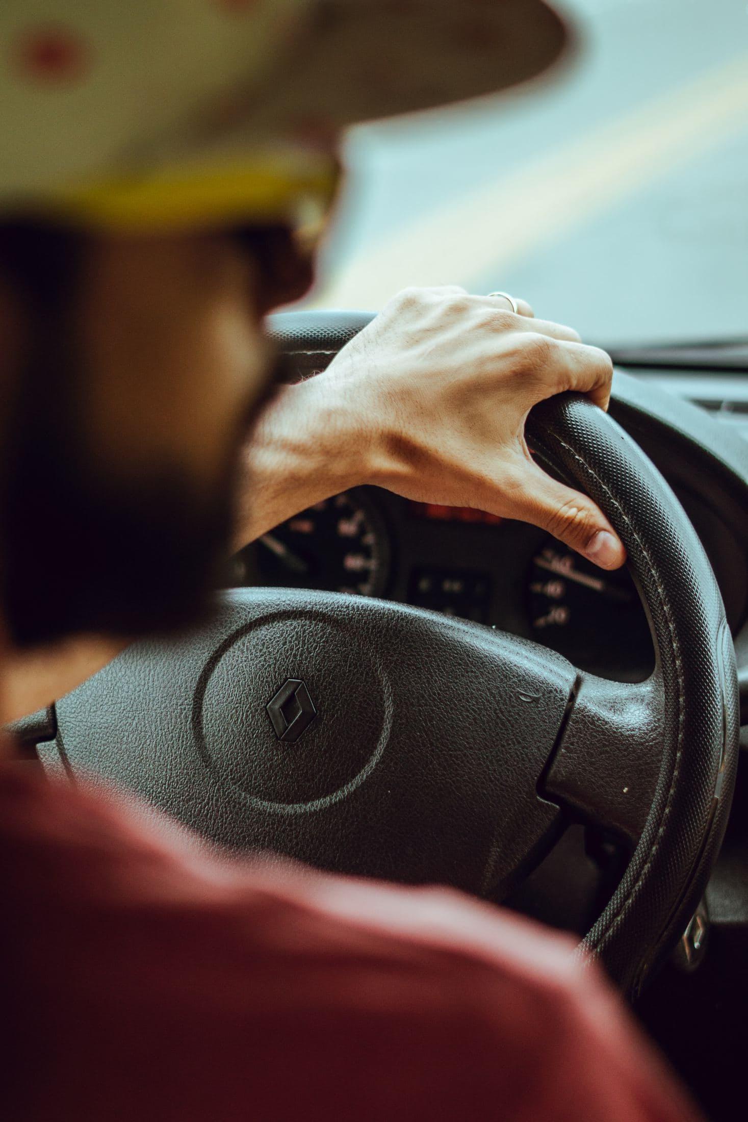 man driving Renault vehicle