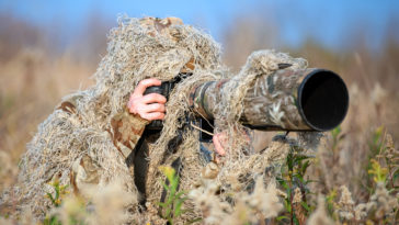 wildlife photographer in the ghillie suit working 2021 04 02 19 37 42 utc