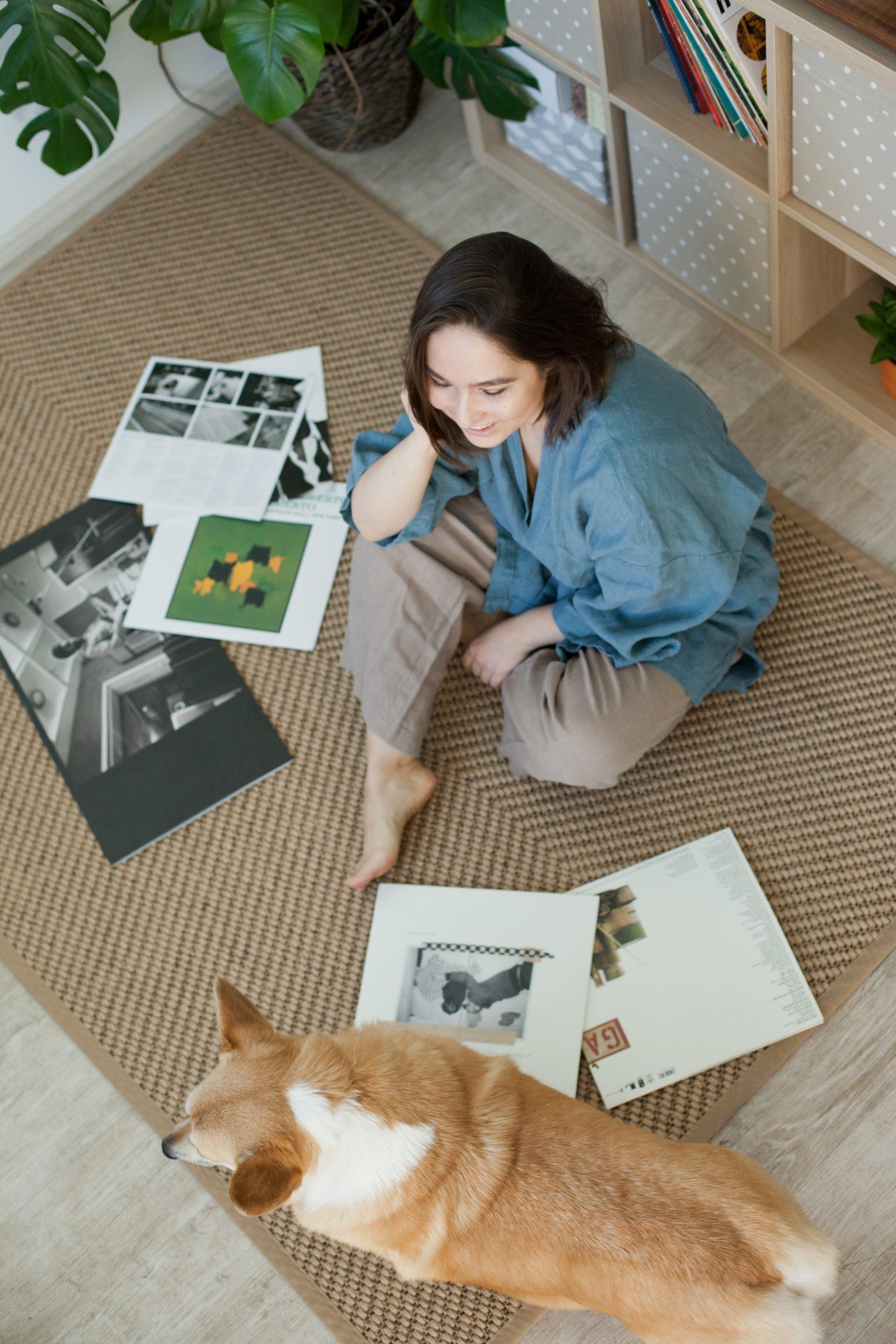 woman at home with corgi dog sitting on a jute rug 2021 04 27 17 20 47 utc