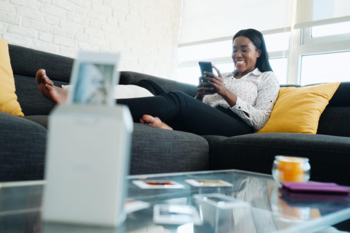 woman printing photos with wireless printer 2021 04 03 19 35 49 utc