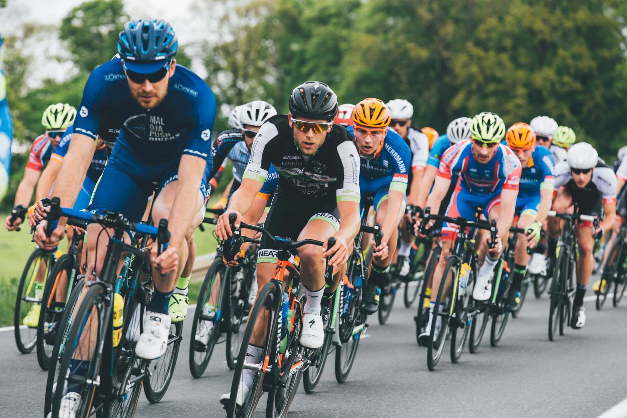 group of cyclist on asphalt road
