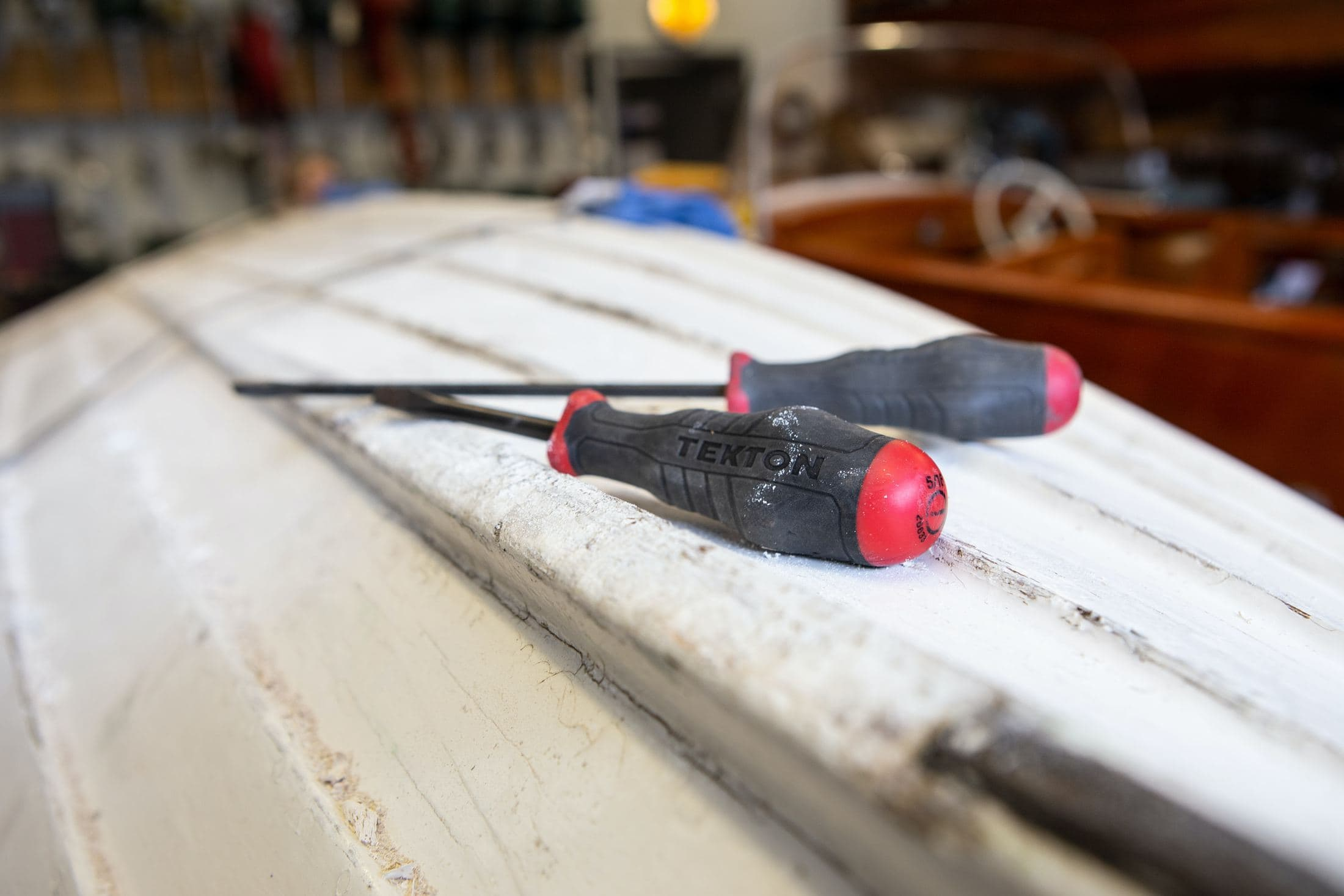 black and red hand tool on white table