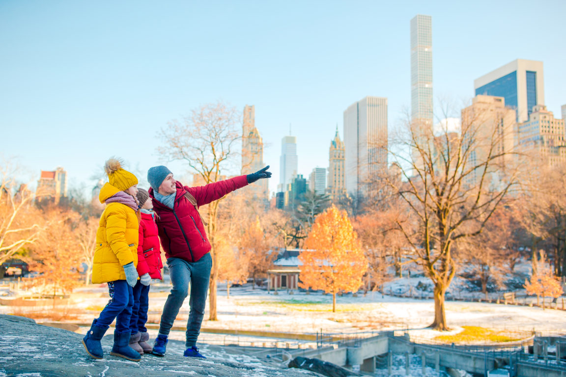 family of father and kids in central park during t QDTAH6D