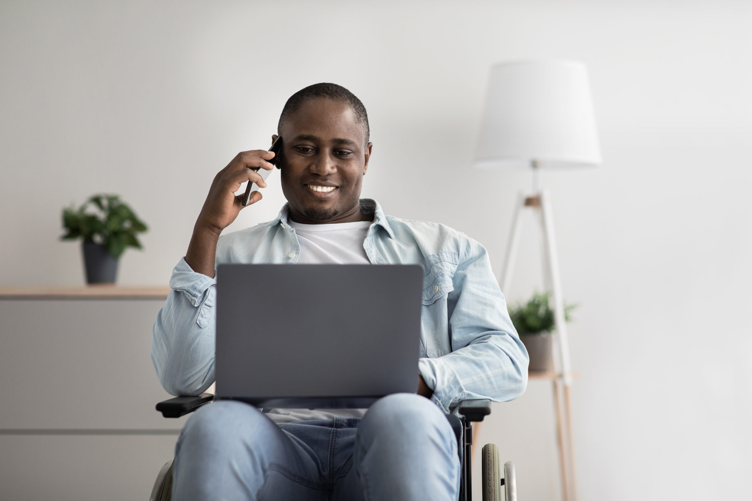 manager works remotely online business and gadgets DKG3DJF