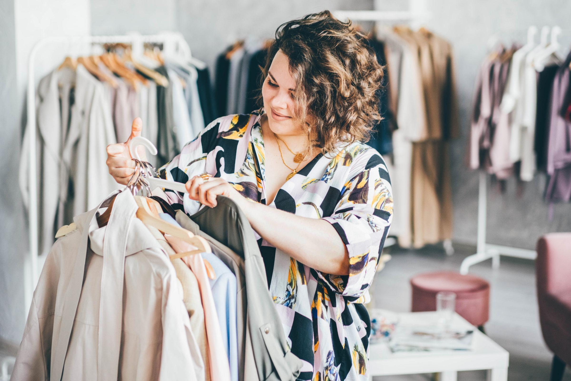 plus size woman choose fashioned dress in store pl 4MQLJGT
