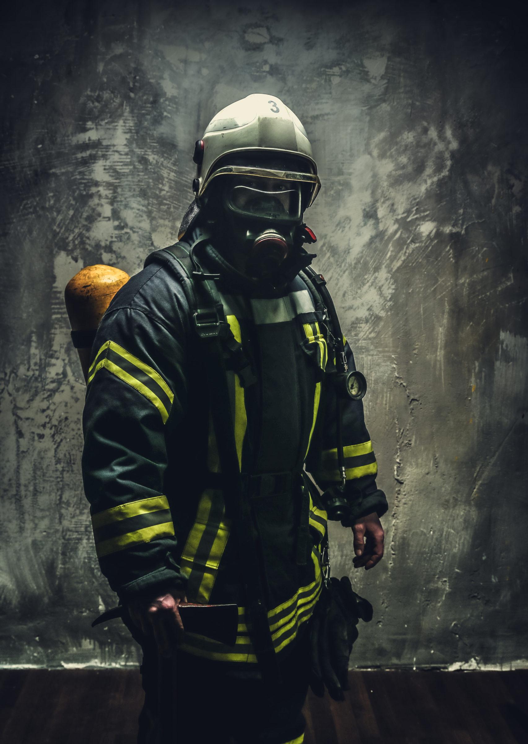 rescue man in firefighter uniform H8WGST4