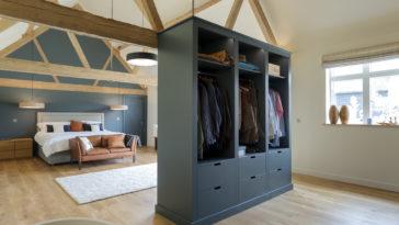 wardrobe and bed in modern bedroom 3YLTXCQ