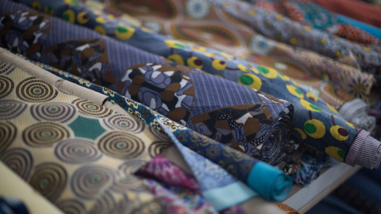 assortment of african print cloth on rack 9KT36TG