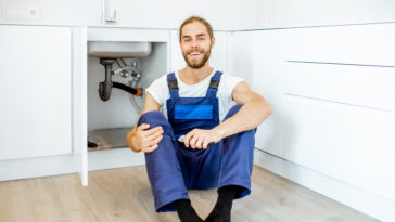 handsome plumber at the kitchen KGCTM9P