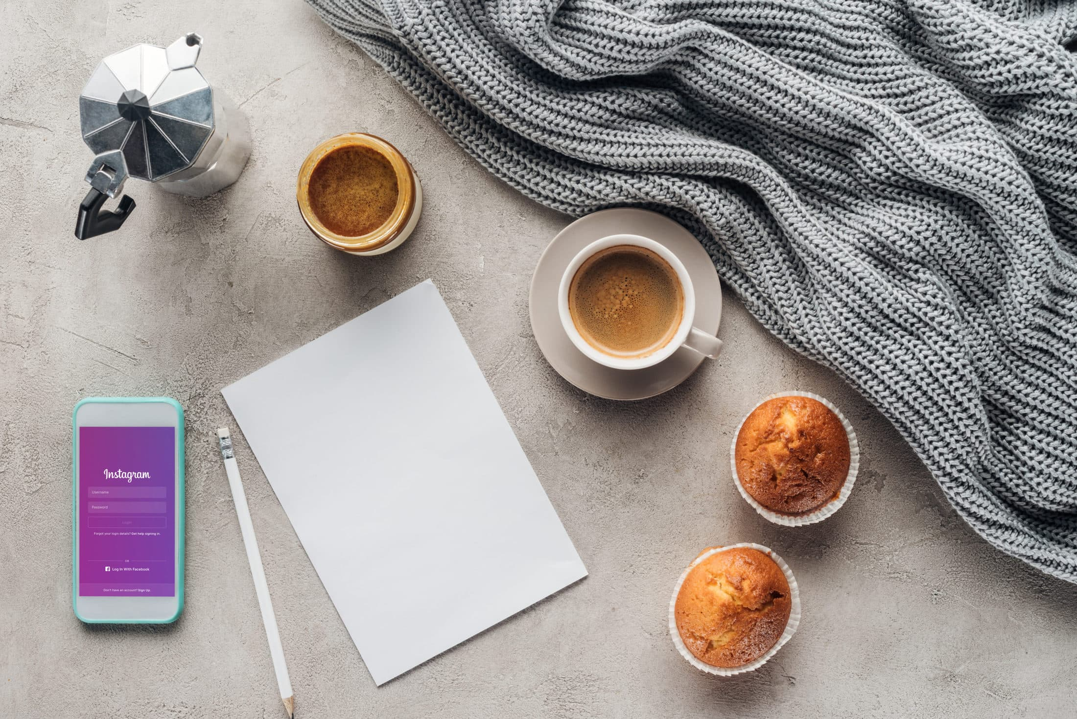 top view of cup of coffee with muffins blank paper UBJZ7LL scaled