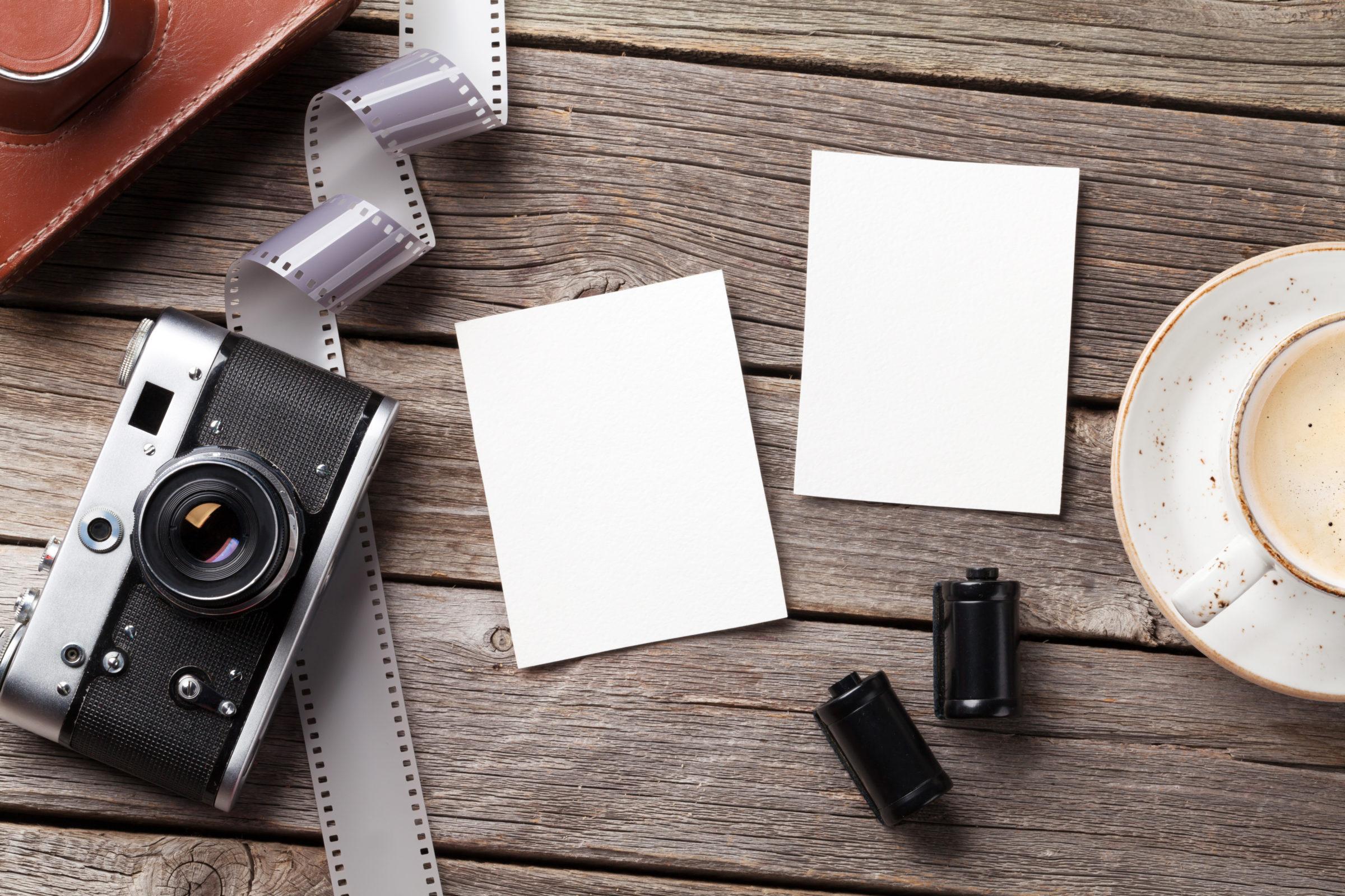 vintage camera and blank photo frames 97ETPBC