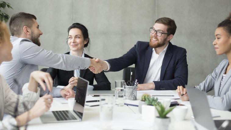 boss shaking hands with employee at meeting 2021 08 30 02 33 45 utc