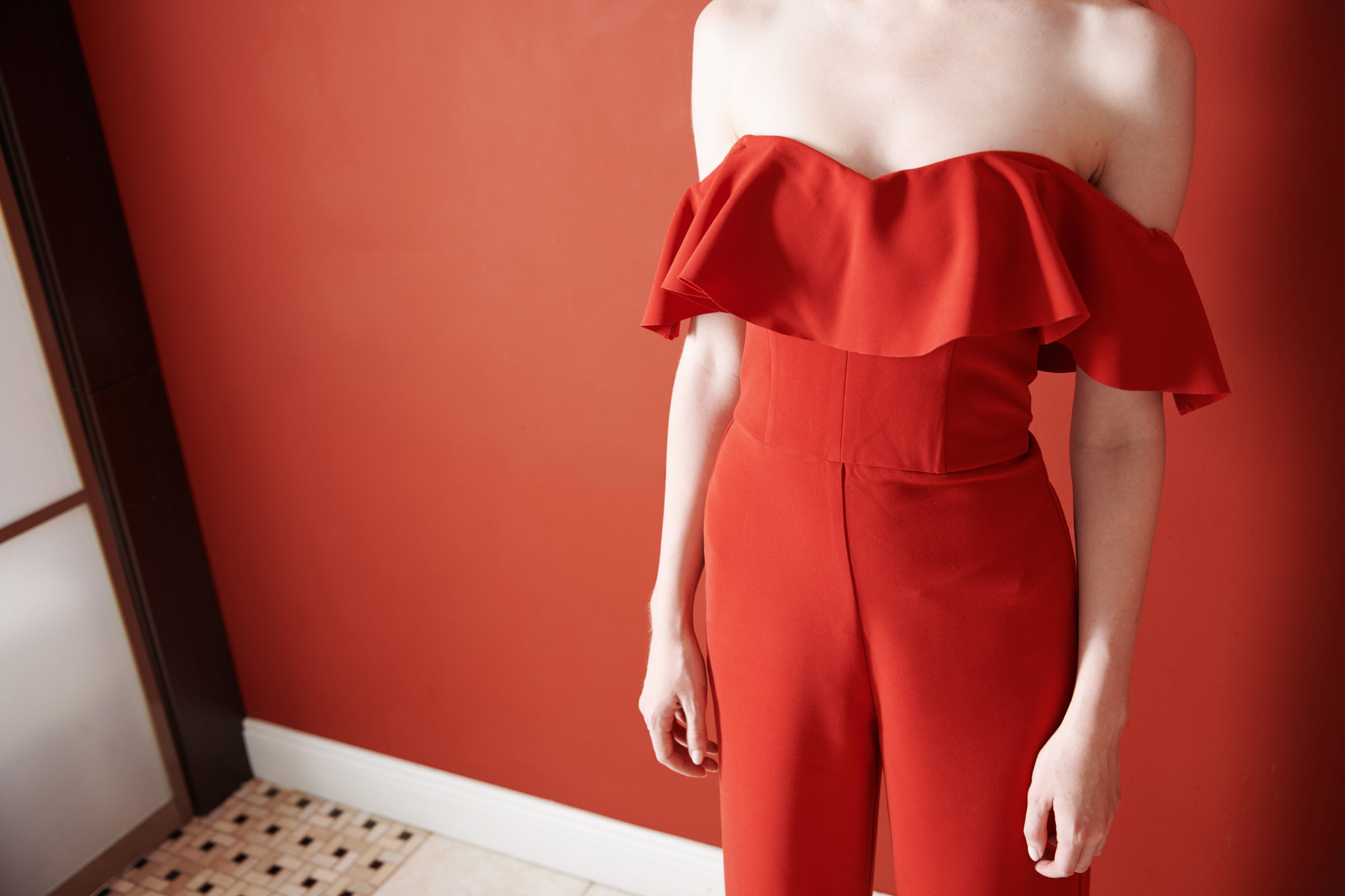 young adult woman wearing red jumpsuit and standin KRDXDLX